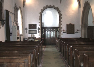 The Nave looking west showing the window to the bell tower installed in 1959.