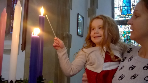 Willow lights the candle of Joy