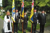 Revd. Carolyn Tibbott with standard bearers.