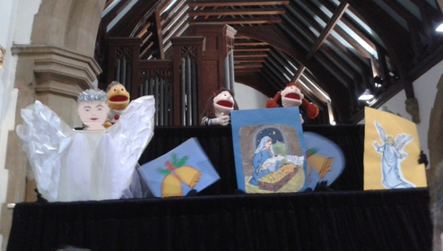 The puppets delighted the children with two Christmas songs