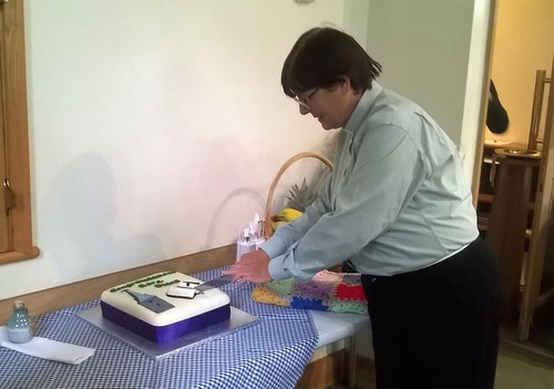 Diana, cutting the cake,